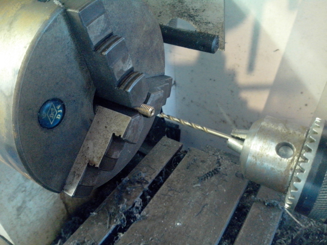 Drilling out a hot-end barrel, lathe not necessary, a standard hand drill can be used instead